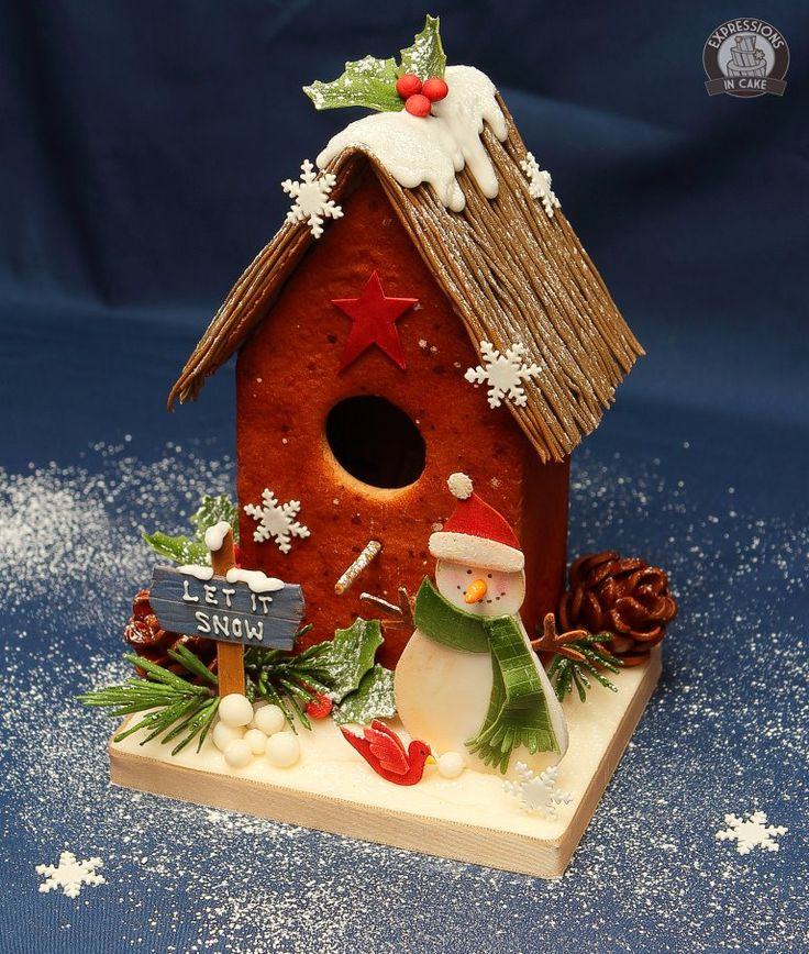 Gingerbread snowman birdhouse w/ edible decorations. https://www.facebook.com/pages/Expressions-in-Cake/286620766001?id=286620766001=photos_stream