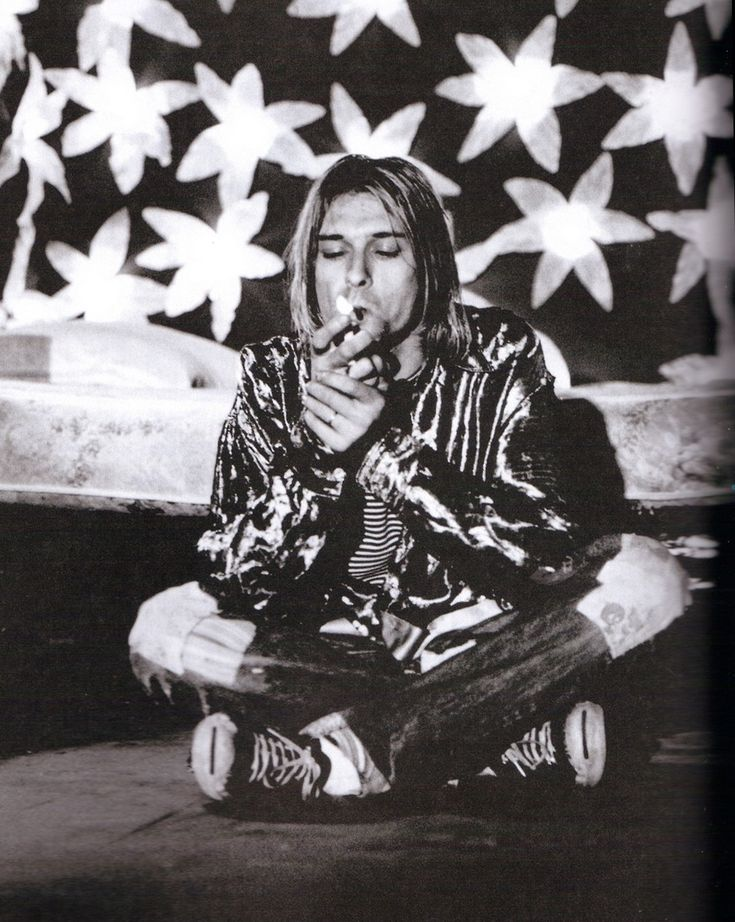 nirvananews: Kurt Cobain taking a smoke break while filming 'Heart-Shaped Box.' [x]