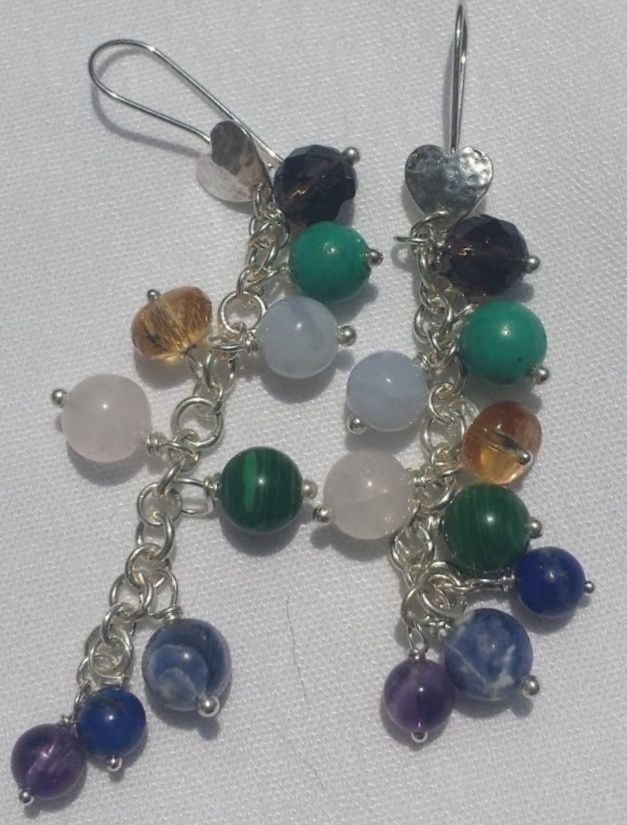 Sterling silver earring with various chakra stones.  $40 Semi-precious stones hand wrapped.  Stones are chosen to help balance and increase wellness in all 7 chakra areas for the wearer.
