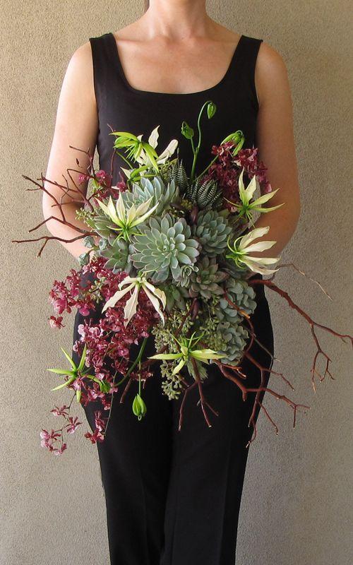 cascading bridal bouquet with natural manzanita, uluhe fern curls, Oncidium Sharry Baby, white gloriosa lilies, Graptoveria 'Bella', Pachyveria glauca 'Little Jewel', Kalanchoe tomentosa, Echeveria' Mazarine', Echeveria 'Violet Queen', Echeveria runyonii 'Topsy Turvy', eucalyptus bells, seeded eucalyptus, wooley bush, and Haworthia fasciata for a ceremony on South Mountian in Phoenix