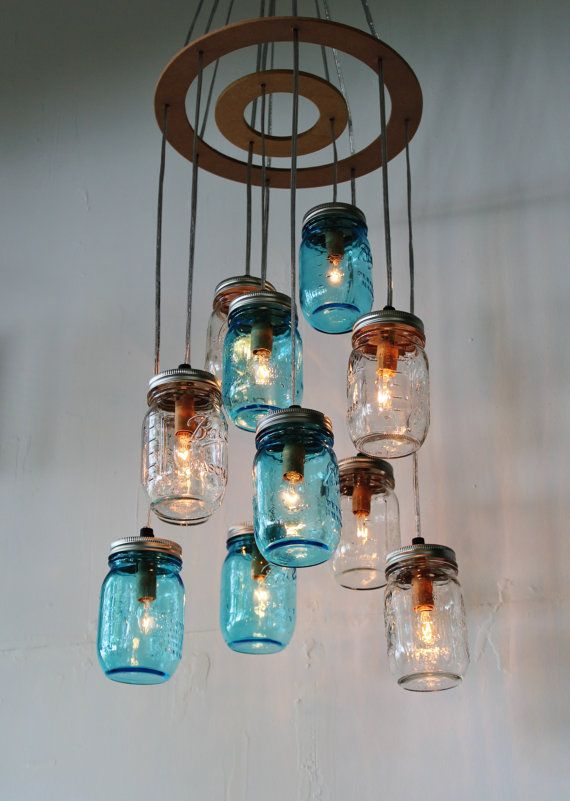 Our clustered mason jar chandelier is the perfect addition to any room! Ideal in the kitchen over an island or table or in the living room for a unique