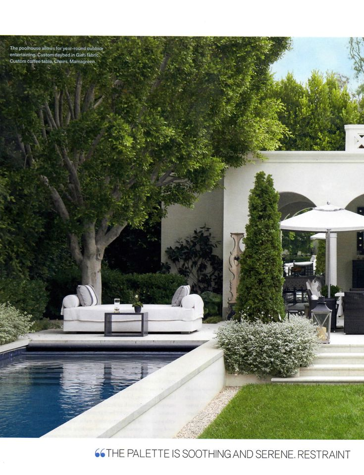 Veranda Dec 2013. Beautiful sleek and modern outdoor pool and large arch openings. Green space