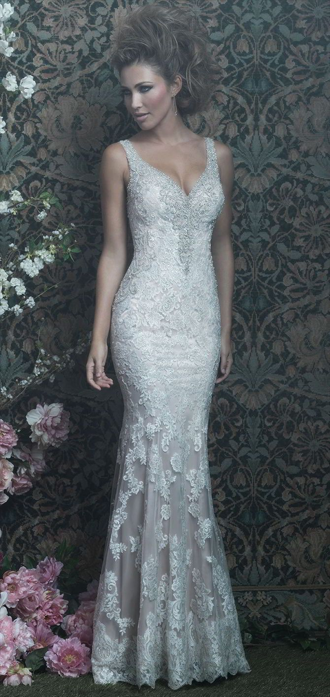 Visit Lovia Bridal Boutique for the best selection of of designer wedding gowns in the Cheshire area. Look no further when searching for that dream dress! Step in to our store of visit us on or web site at www.loviabridal.co.uk This delicate sheath features a vintage appeal in a silky slip dress and a sheer lace-covered overlay.