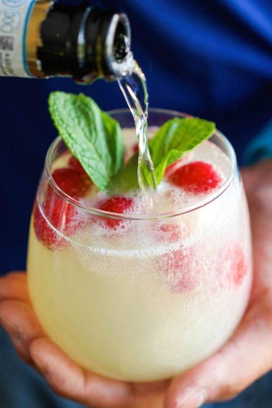 frozen raspberries, 1 part limoncello, 3 parts prosecco, sprigs of fresh mint
