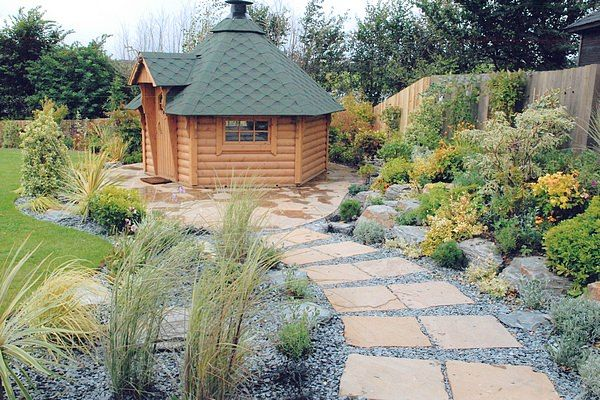 Complete Garden Makeover with sauna placed on curved patio