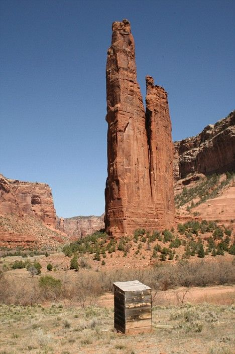 canton de chelly, arizona: A wooden loo at the base of spider rock, an 800ft sandstone spire revered by navajo indians