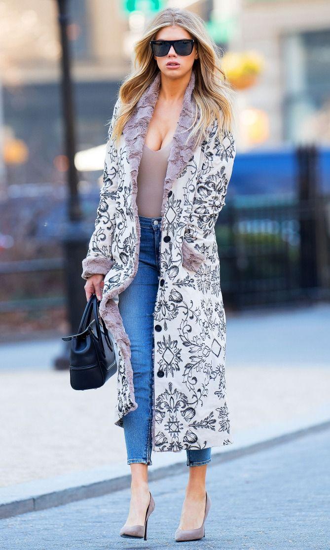 Charlotte McKinney in a pattern coat, bodysuit, skinny jeans and heels
