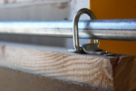 Great #Tutorial on how to build a sliding (track) door cheaply with special hooks and castors. I think this also works on so many other things, like a sliding window treatment or wall divider.