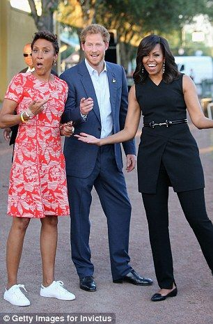 Harry seems to revel in being a hard working, 'real' royal. His many television interviews are suffused with his wit and passion.  He's pictured here with Good Morning America host Robin Roberts and Michelle Obama for a Monday interview