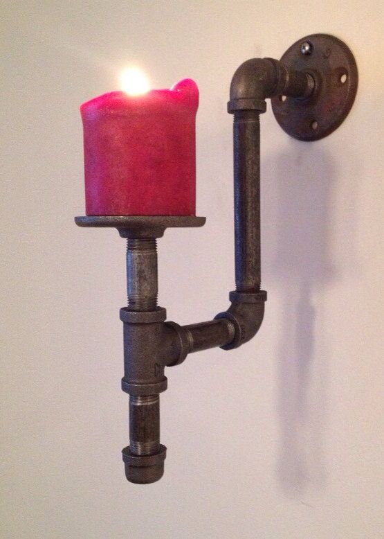 This sturdy metal sconce is made from recycled black carbon steel pipe and fittings. It will make a great addition to your home next to your artwork or pictures. Dont forget to check out our candelabra made from pipe as well! https://www.etsy.com/listing/210137269/recycled-pipe-candle-holder  *candle is not included