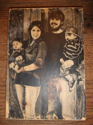 Print your family photos on wood: Print your picture out on plain paper, Take piece of wood and coat with mod podge, turn picture upside down on wood press and let dry overnight. next day using water and your hands rub paper off of wood (your picture will be on the wood) now cover with more mod podge.