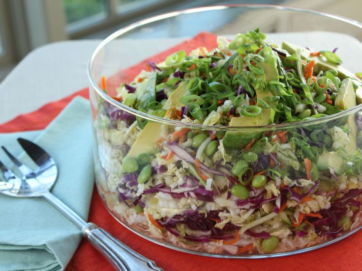 Ty's Thai Salad recipe from Trisha Yearwood via Food Network  1 head Napa cabbage,  1 head red cabbage, shredded 1 large cucumber One 10-ounce bag shelled edamame 2 carrots, peeled and grated 2 green onions, finely sliced Sweet Lime-Cilantro Dressing: