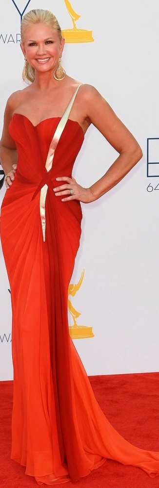 Curvy floor length hip draping strapless red gown w/ one gold lamay shoulder strap - Nancy O'Dell