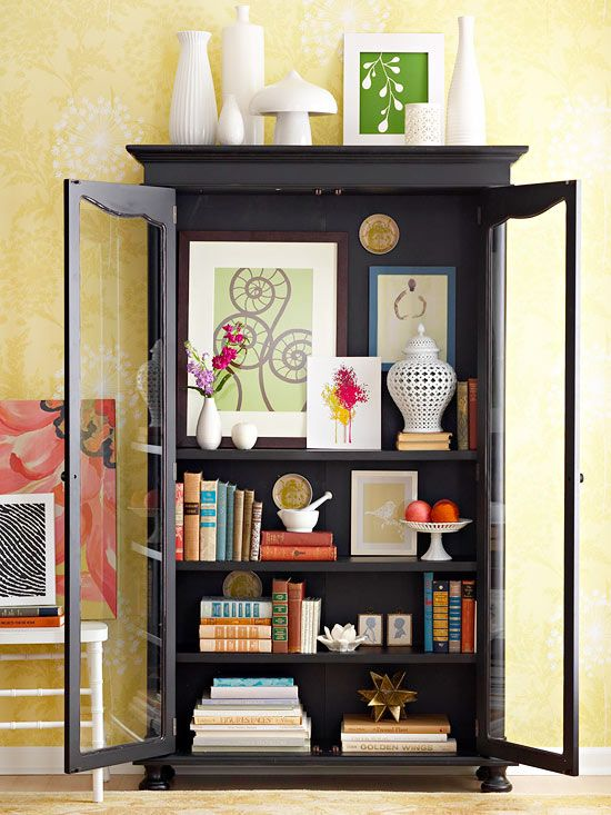 We love this colorfully decorated bookshelf! More high impact decorating ideas: http://www.bhg.com/decorating/lessons/expert-advice/home-decorating-ideas/#page=1