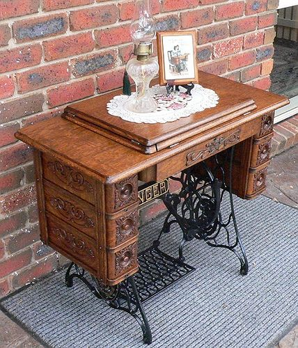 Years ago I saw a antique sewing machine and table like this in a thrift shop window and it was already white (it looked like it was factory painted, not a home amateur job). It was there for months and I finally broke down and went in to buy it only to see another woman loading it into her car. It was only $188 but I had no room for it in my apartment at the time. I'm still looking for it's twin.