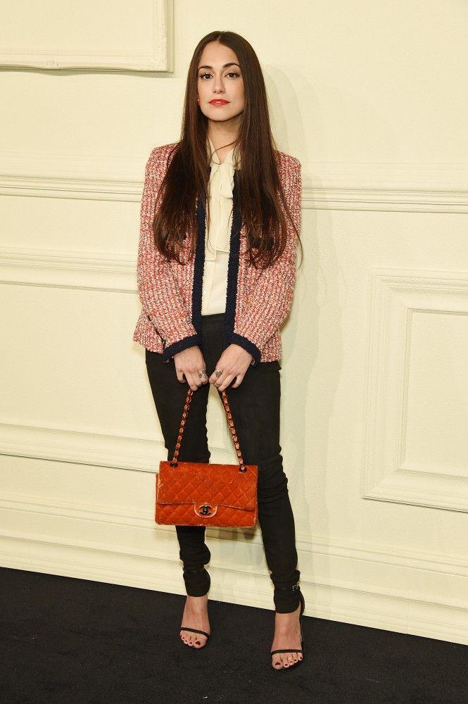 Audrey Gelman in a tweed jacket, black pants, and black ankle strap heels at Chanel's Paris-Salzburg show in NYC