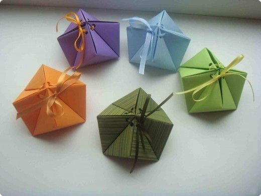 """Origami gift box...I made one from this site. The boxes are larger than they look in the picture (about 4""""x4""""), and the instructions are in Japanese, but the pics are clear enough if you've ever done any paper folding to be able to follow except for the placement of the holes for the string.  I used cardstock just to try it out, which I don't recommend."""