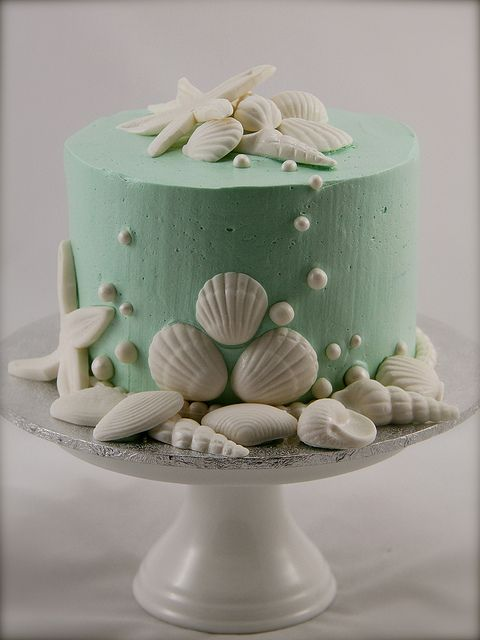 this is a cake, but...you could do the same thing with a large candle, just eliminate the shells around the wick. Pretty.