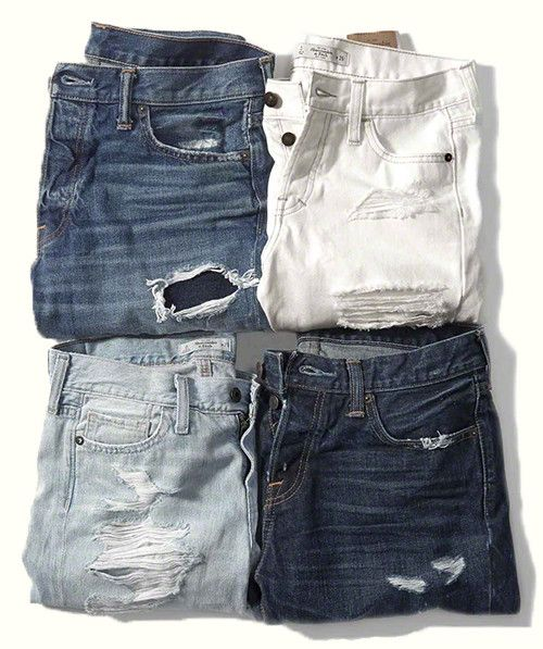 Four pairs of folded jeans