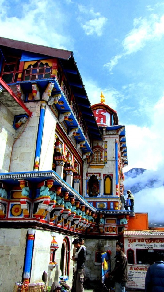 Badrinath Temple dedicated to Lord Vishnu,  in the upper Himalayas, one of the four Hindu Holy Char Dham Pilgrimage Sites......It's on the banks of the Alakanada river, which eventually meets the Bhagirathi river to form the river Ganga......Build in the 9th century, the architecture takes inspiration from a Buddhist Vihara (temple), with the brightly painted facade typical of Buddhism temples.