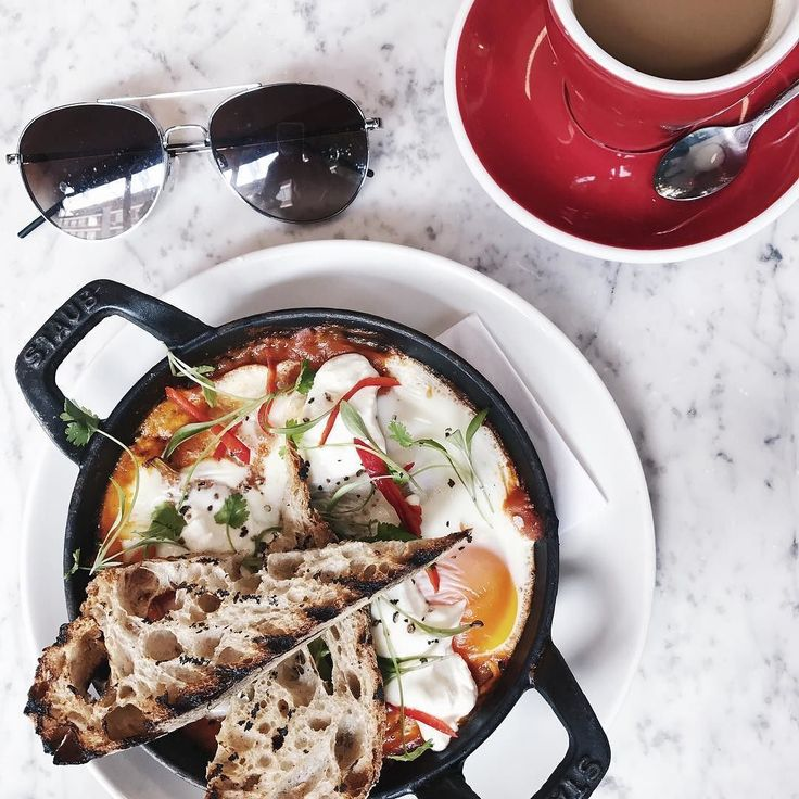 "Shakshouka breakfast at @grind exmouth market. And Stag's sunglasses (I stole them ). The staff at Grind are always so friendly and welcoming and they don't mind when I eat all their food and stay forever. One of my favourite working spots in London.  #notanad - just a ""laptop nomad"" Londoner who's eaten and worked everywhere"