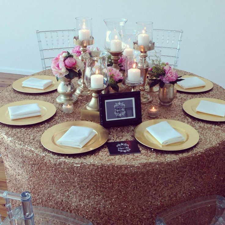 Beautiful centrepieces and a creative  change to the typical white table linen http://whenlovesparks.com.au/