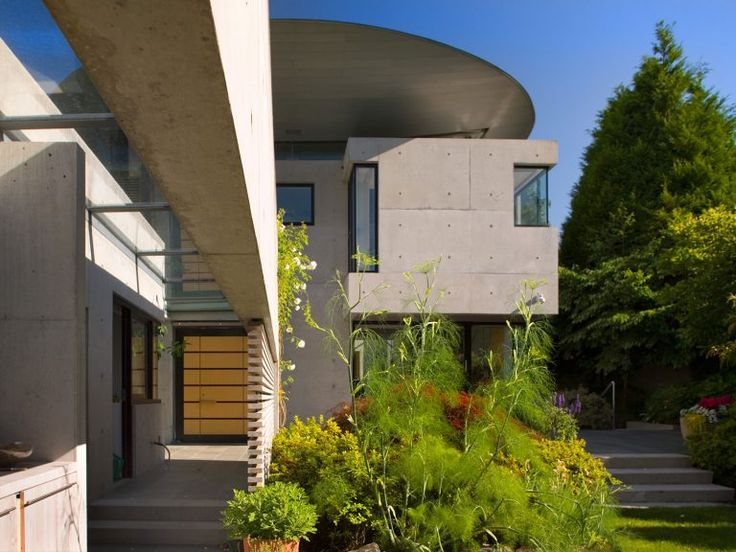 This private house, located on a corner site at the University Endowment Lands in Vancouver, forms a symbiotic relationship with its immediate landscape. With simple massing, a high degree of transparency, and an expressive roof structure, the house hugs its garden. Views unfold sequentially from the house, giving a 360-degree panorama of the surrounding landscape. The 6,000-square-foot house is organized on three levels – living on the main level, sleeping on the second, and playing in the…