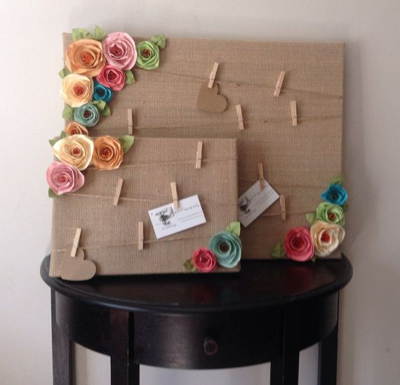 This adorable shabby chic style message board is covered in burlap and has twine with mini clothespins attached to hold you photos and messages! The crinkle spiral flowers are each hand cut and hand sculpted and can customized to include any colors!! These make perfect house warming, birthday, holiday and wedding gifts. I can even ship with a personal message attached from you.  These boards are available in small - 9 x 12, medium - 12 X 12, or large - 16 x 20  Please convo me about colors…