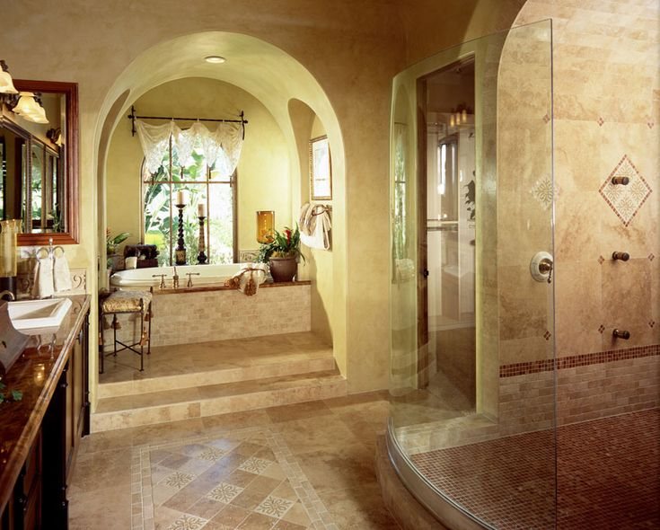 Mediterranean style tile bathroom with brown color theme and arched doorway to tub. 1000  ideas about Brown Mediterranean Style Bathrooms on Pinterest