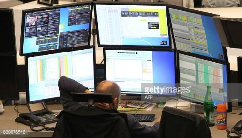A trader works at the German Stock Exchange in Frankfurt am... #annweileramtrifels: A trader works at the German Stock… #annweileramtrifels
