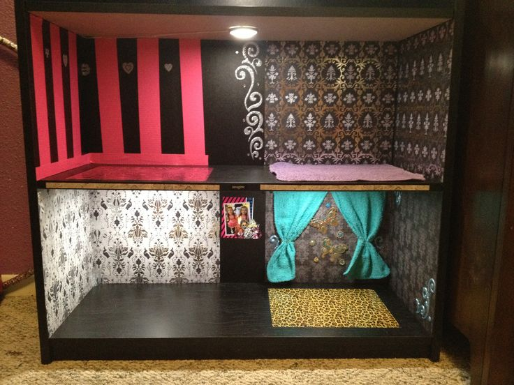 Monster High DIY doll house with lights. Black bookshelf, Scrapbook paper as 'wallpaper'. Duck tape sheets for the floors. Wash cloths as carpet and curtains.