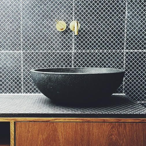 Made a Mano and Københavns Møbelsnedkeri | Bathroom details KN./15 tiles and lava stone sink #onehideaway #34nord www.madeamano.com tap from hola
