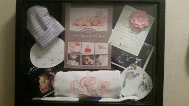 Birth shadow box.  Pregnancy test, birth announcement, sonogram photos, hat after delivery, birth feet prints, hospital birth card, gender announcement card.