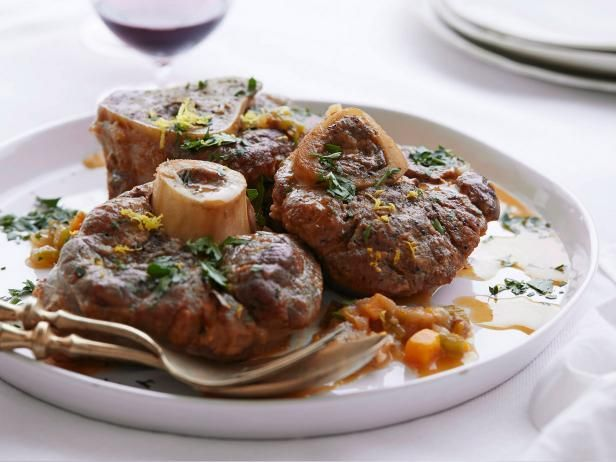 Giada's Osso Buco - This hearty meal combines veal shanks, fresh rosemary and thyme, and assorted veggies to create the perfect dish to have simmering on your stovetop this Sunday. http://www.foodnetwork.com/recipes/giada-de-laurentiis/osso-buco-recipe