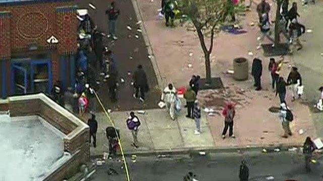 Violence erupts in Baltimore as roving gangs attack police, torch patrol car, loot stores following Freddie Gray funeral