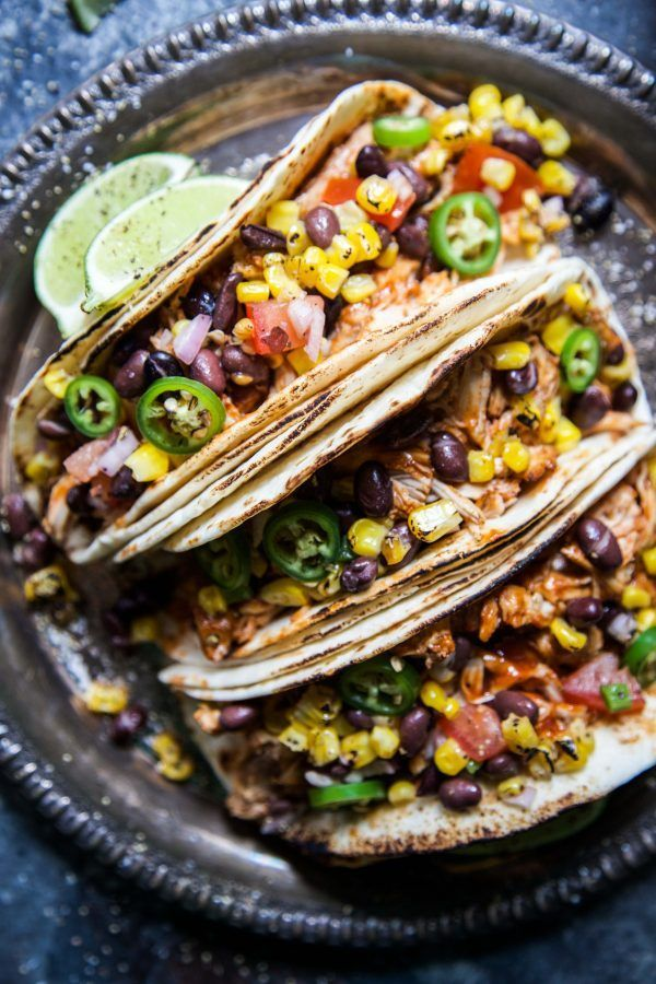 Slow Cooker BBQ Chicken Tacos with Texas Caviar is an easy and delicious summer meal! Slow cooked juicy barbecue chicken stuffed into a soft tortilla and then topped with fresh Texas Caviar. These tacos will be in your regular summer dinner rotation! Hello, Hello, Hello! How are you on this fine Monday morning? I hope …