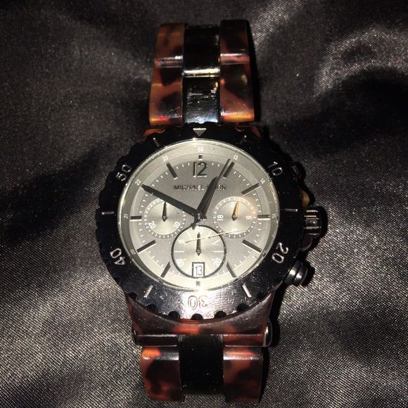 Michael Kors Tortoise Shell watch Great condition MK watch it's a men's watch but I like it as an over sized watch for women's I wear it with chunky bracelets (: Michael Kors Jewelry