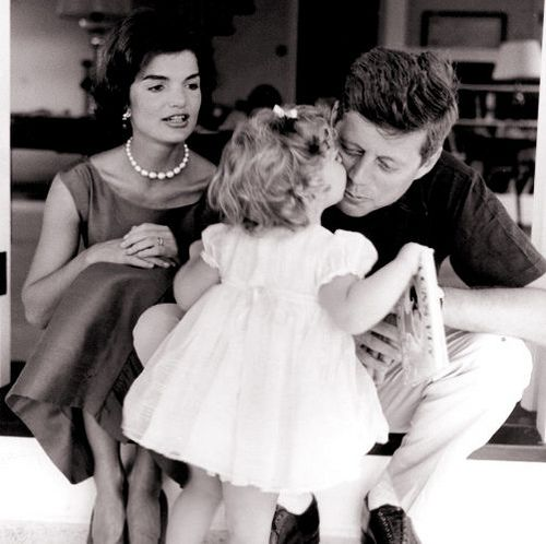 Caroline giving her daddy a kiss. Many believe the Kennedys are the closest America will ever get to royalty.