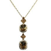 "Colorful and dazzling, this elegant pendant and chain shines like no other. Features a 3.83 carat Whiskey Quartz, accented by 0.25 carat of round cut Diamonds and 0.46 carat Citrines, suspended from a dainty 18"" 18K yellow gold chain. Perfect for special occasion wear.   Citrine is the modern November birthstone. CONTACT US FOR MORE INFORMATION! T: 5148452900 OR info@eskimofire.com"