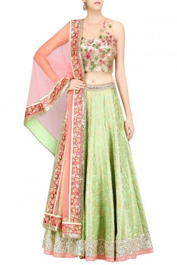 Amit Sachdeva A green paisely pattern handwoven brocade lehenga skirt paired with gold sheer blouse with anchor work floral embroidery all over to give a color pop. It comes along peach net dupatta with golden floral embroidery all over and bling at the boder.