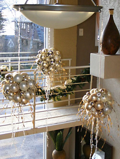 Create clusters of ornament balls & suspend from ceiling w/ ribbon, or fishing wire to create a floating illusion. Love This !!