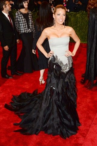 Blake Lively wore a Gucci Première strapless gown, her hips smothered in feathered embroidery.