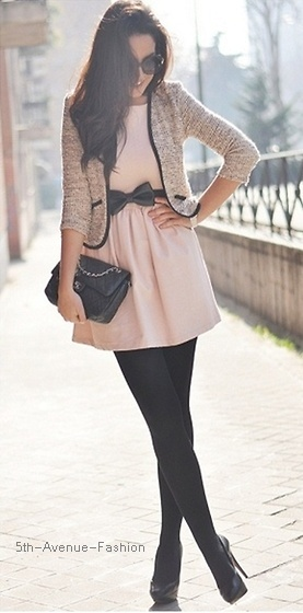 Adorable, tweed jacket with black trim, pink dress with a bow belt, black tights, Black Chanel bag