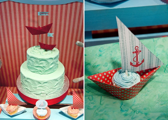 aqua & red sailing party: darling use of folded paper boats as cupcake holders