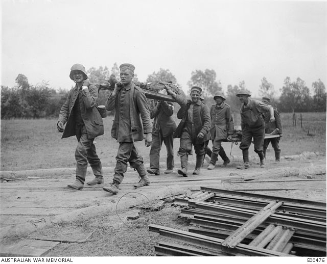 German prisoners near Plum Duff trench, acting as stretcher bearers during the Battle of Messines. 7 June, 1917.
