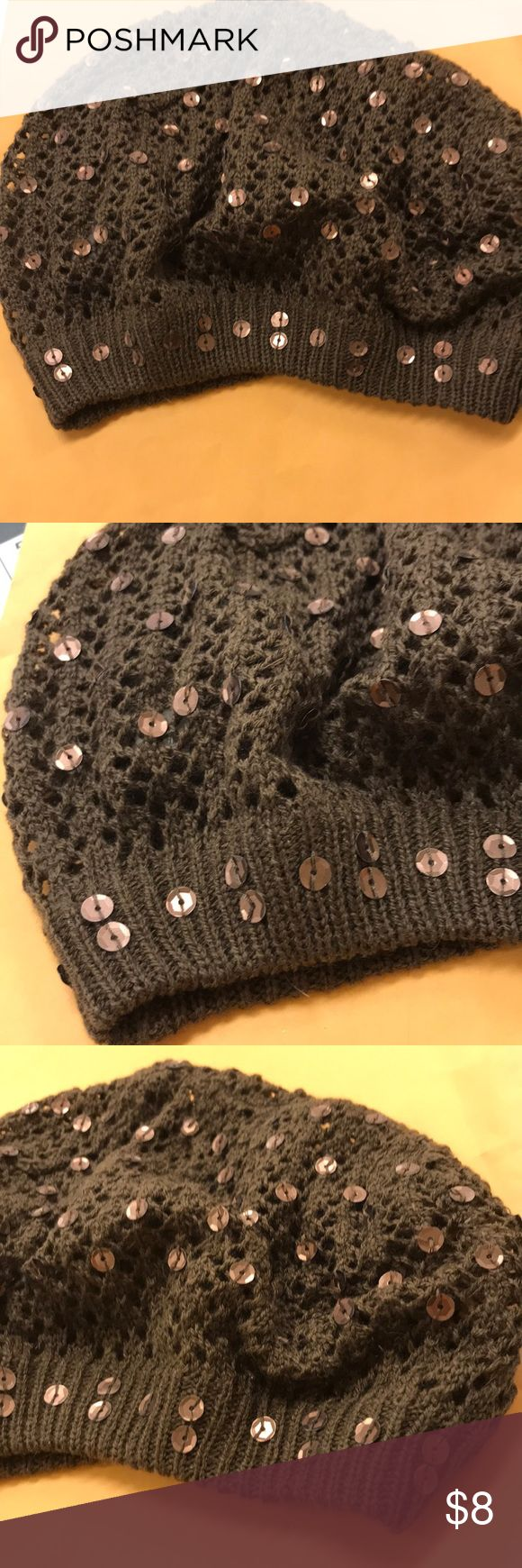 NWOT Crocheted Beanie Dark Brown Sequins New without tags. Loosely crocheted dark brown beanie with brown sequins. Dresses up any outfit! Accessories Hats