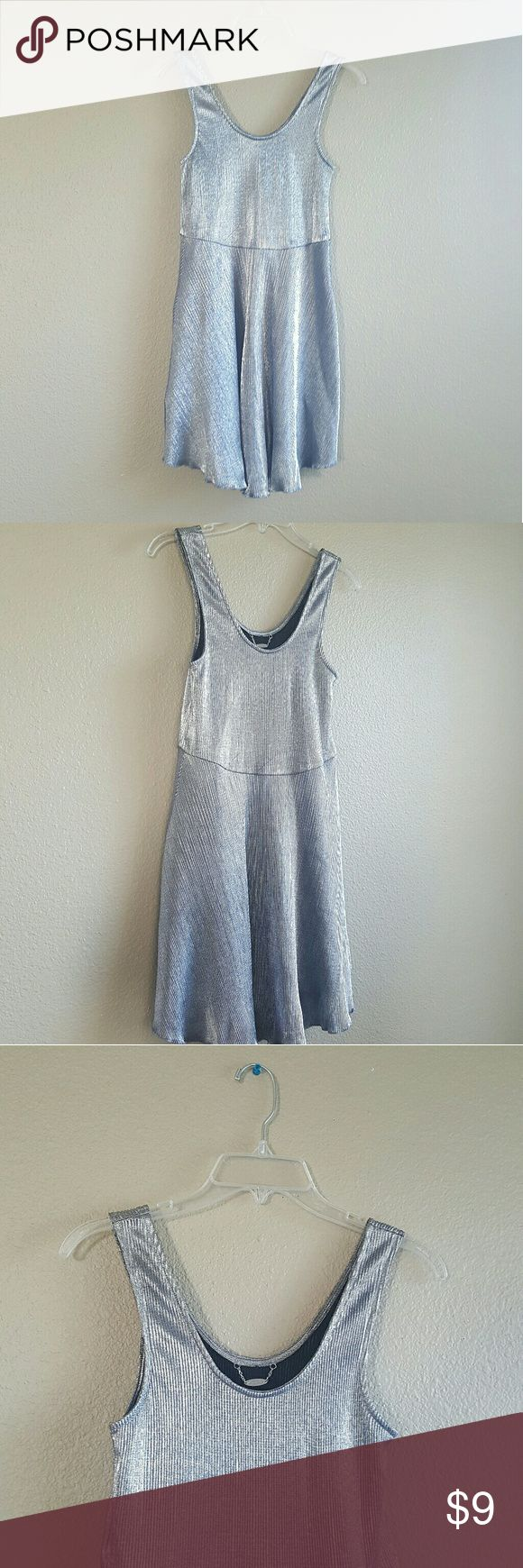 SHINY SILVER SUMMER DRESS This suuuuper cute dress sparkles and SHINES!!!! I am reposhing this dress because it is too small in the bust for me... It is in perfect condition and it's very comfortable!! Hits a tad above the knees and the way it lays on the body is suuuuper flattering!!! She's a beauty!! Ali & Kris Dresses