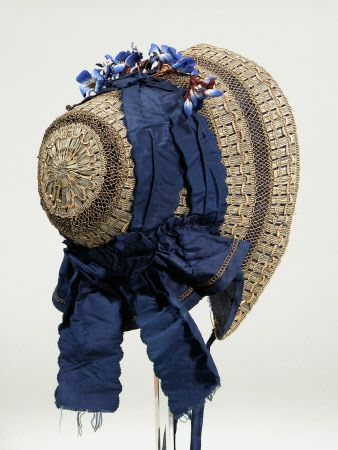 A beautiful navy blue ribbon adorned straw bonnet, c. 1840 - 1850. #Victorian #1800s #fashion #hats