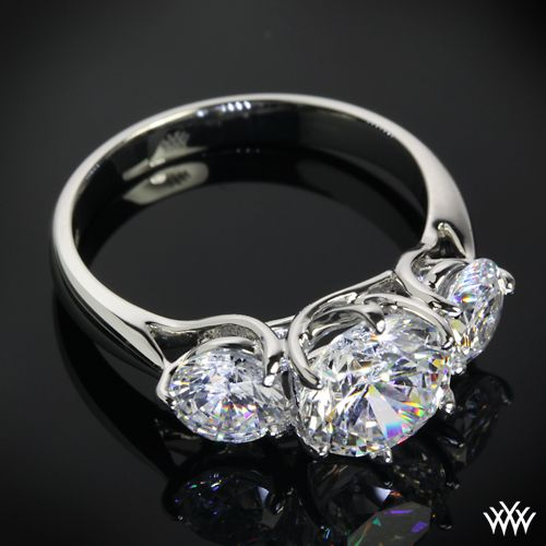 """Butterflies"" 3 Stone Engagement Ring incorporates sweeping lines that twist to create one unforgettable ring. 2.00ct Round Center Stone set in Butterflies Diamond Engagement Ring"