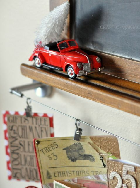 vintage toy car hauling christmas tree